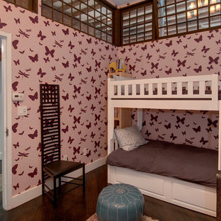 Design ideas for an industrial toddler's room for girls in New York with dark hardwood flooring and multi-coloured walls.
