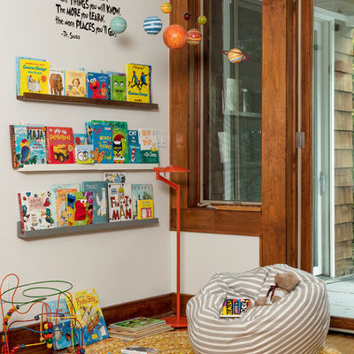 Transitional gender-neutral medium tone wood floor and brown floor playroom photo in Other with white walls