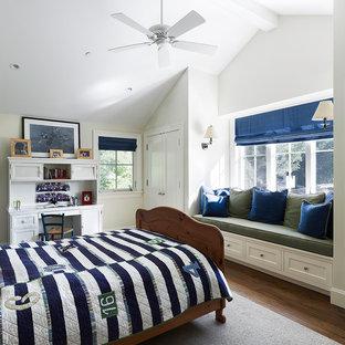 Elegant boy dark wood floor kids' bedroom photo in San Francisco with white walls