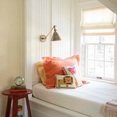 Example of a classic gender-neutral kids' room design in Boston with beige walls