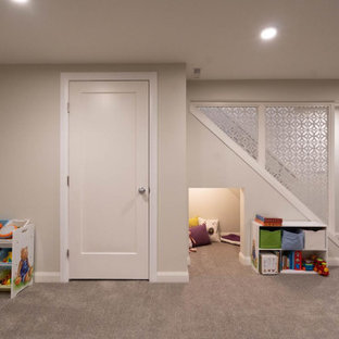 Photo of a large midcentury kids' room in Calgary with beige walls, carpet and brown floor.