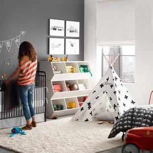 Idee per una cameretta per bambini da 1 a 3 anni classica di medie dimensioni con pavimento in cemento e pareti multicolore