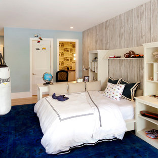 Example of a large transitional boy light wood floor kids' room design in Miami with blue walls