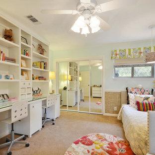 Foto de dormitorio juvenil actual con escritorio