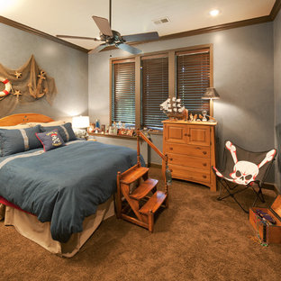 Example of a coastal gender-neutral carpeted kids' bedroom design in Kansas City with gray walls