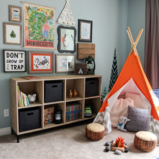 Mid-sized transitional boy carpeted and beige floor kids' room photo in Other with blue walls