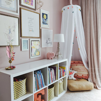 Inspiration for a mid-sized transitional girl carpeted and beige floor kids' room remodel in Other with pink walls