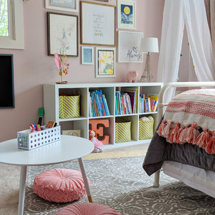 Kids' room - mid-sized transitional girl carpeted and beige floor kids' room idea in Other with pink walls