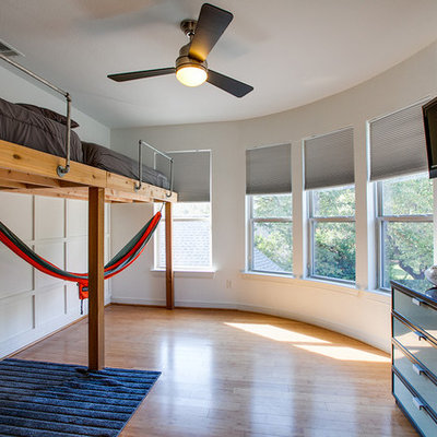 Mid-sized transitional boy light wood floor kids' room photo in Dallas with white walls