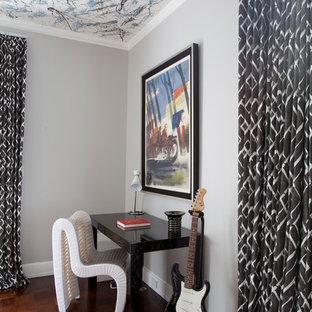 Teen room - contemporary boy dark wood floor teen room idea in Houston with gray walls