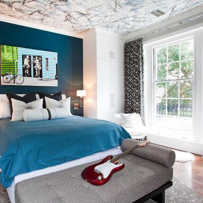 Trendy boy dark wood floor kids' room photo in Houston with multicolored walls