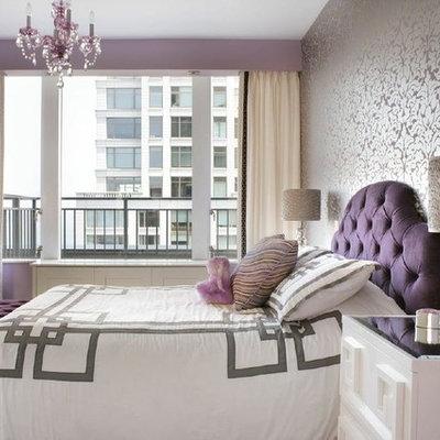 Mid-sized trendy girl medium tone wood floor kids' room photo in New York with purple walls