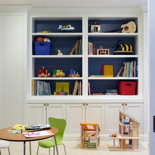 Design ideas for a medium sized bohemian gender neutral toddler's room in New York with blue walls and carpet.