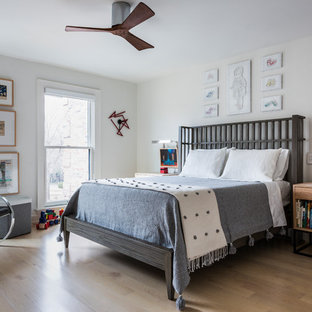 Inspiration for a mid-sized contemporary boy light wood floor and beige floor kids' room remodel in Chicago with white walls