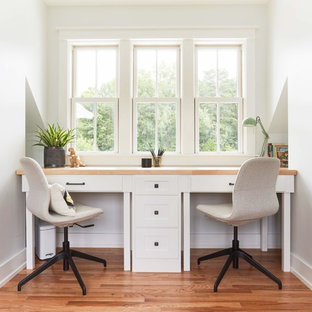 Kids' room - mid-sized farmhouse gender-neutral medium tone wood floor and brown floor kids' room idea in Richmond with white walls
