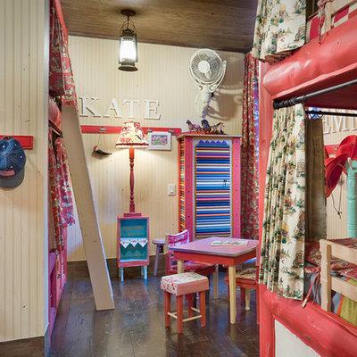 Mountain style girl dark wood floor kids' room photo in Denver with beige walls