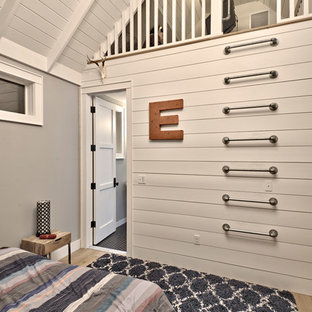 Kids' room - large farmhouse boy light wood floor and brown floor kids' room idea in Austin with gray walls