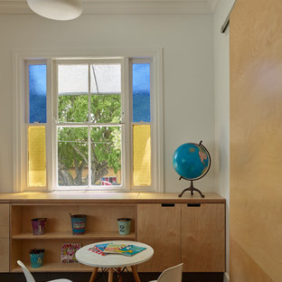 Photo of a contemporary gender-neutral kids' playroom in Brisbane with white walls, medium hardwood floors and brown floor.