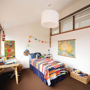 Inspiration for a small contemporary toddler room for boys in Sydney with white walls and carpet.
