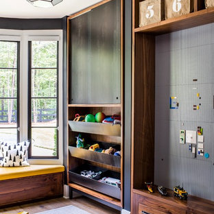 Inspiration for a beach style boy playroom remodel in Atlanta with black walls