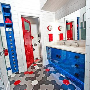 Foto di una cameretta per bambini da 4 a 10 anni rustica di medie dimensioni con pareti bianche e pavimento rosso