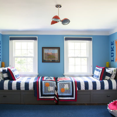 Large transitional boy dark wood floor kids' room photo in New York with blue walls