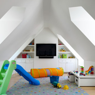 Photo of a transitional gender-neutral kids' room in Dallas with white walls and light hardwood floors.