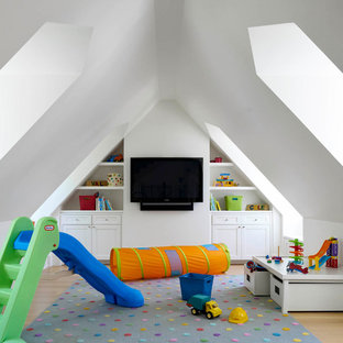 Transitional gender-neutral kids' room in Dallas with white walls.