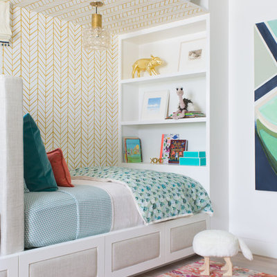 Inspiration for a transitional gender-neutral light wood floor kids' bedroom remodel in San Francisco with multicolored walls