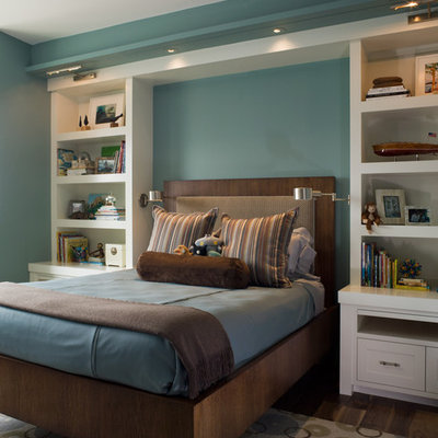 Example of a transitional boy dark wood floor kids' room design in San Francisco with blue walls