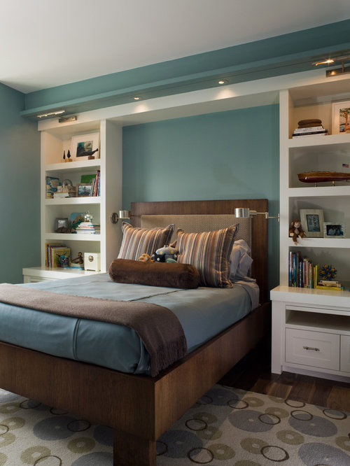 Example of a transitional boy dark wood floor kids' bedroom design in San  Francisco with