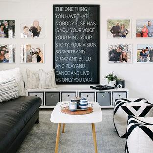 Foto di una cameretta per bambini da 4 a 10 anni contemporanea di medie dimensioni con pareti bianche, moquette e pavimento grigio