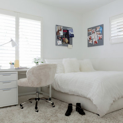 Inspiration for a huge contemporary girl light wood floor kids' room remodel in Los Angeles with white walls