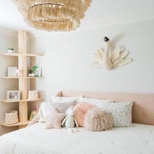 Kids' bedroom - scandinavian girl kids' bedroom idea in San Diego with white walls