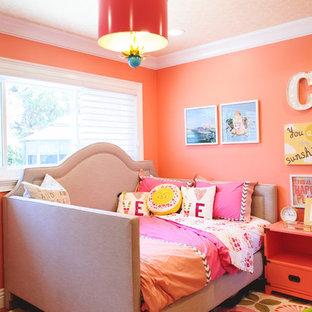 На фото: детские в стиле современная классика с спальным местом, оранжевыми стенами, ковровым покрытием и разноцветным полом для ребенка от 4 до 10 лет, девочки