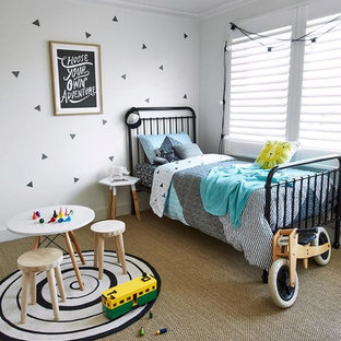 Danish gender-neutral carpeted childrens' room photo in Sydney with white walls
