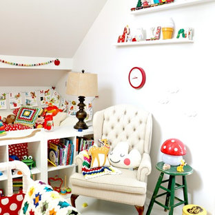 Mid-sized danish gender-neutral painted wood floor and white floor kids' room photo in Las Vegas with white walls