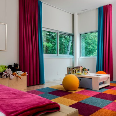 Kids' room - contemporary gender-neutral light wood floor kids' room idea in Indianapolis with white walls