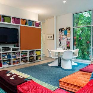 Esempio di una cameretta per bambini minimal con pareti bianche
