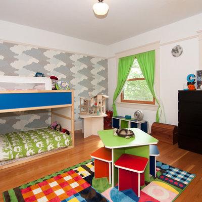 Kids' room - contemporary gender-neutral medium tone wood floor kids' room idea in Portland with white walls