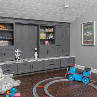 Kids' room - coastal gender-neutral brown floor, shiplap ceiling and vaulted ceiling kids' room idea in Los Angeles with gray walls