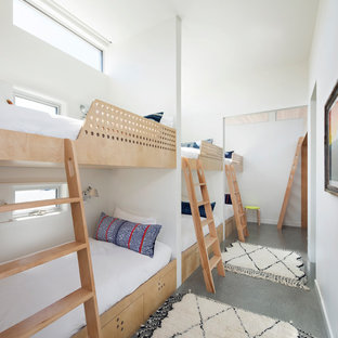 Example of a small coastal gender-neutral gray floor kids' bedroom design in San Francisco with white walls