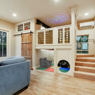 Example of a mid-sized transitional gender-neutral medium tone wood floor and brown floor kids' room design in New Orleans with beige walls