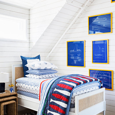 Mid-sized beach style boy light wood floor kids' bedroom photo in New York with white walls