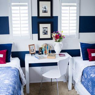 На фото: детская в морском стиле с спальным местом, ковровым покрытием и разноцветными стенами для мальчика с