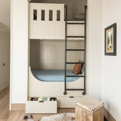 Transitional gender-neutral light wood floor and beige floor kids' bedroom photo in Other with white walls