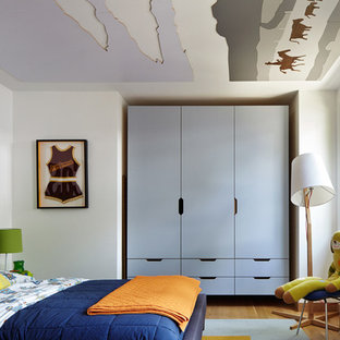 Inspiration for a contemporary boy light wood floor and brown floor kids' room remodel in Kansas City with white walls