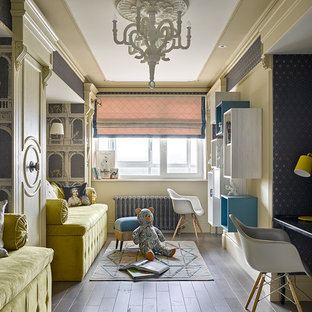This is an example of a traditional gender neutral kids' room in London with painted wood flooring and multi-coloured walls.