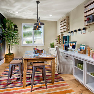 Inspiration for a mediterranean gender-neutral medium tone wood floor kids' study room remodel in Orange County with multicolored walls