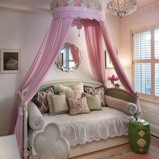 Cottage chic girl kids' bedroom photo in New York with white walls